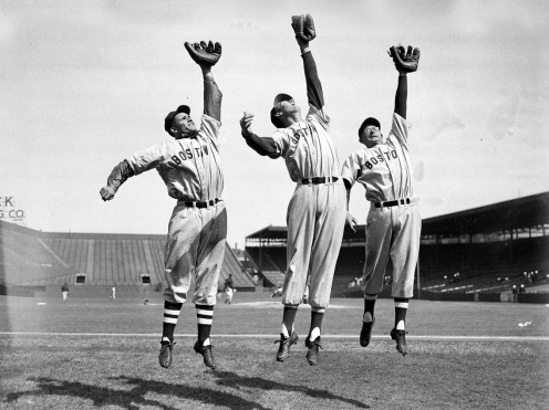 Bobby Doerr, Ted Williams, and Dom Dimaggio leap for the camera.